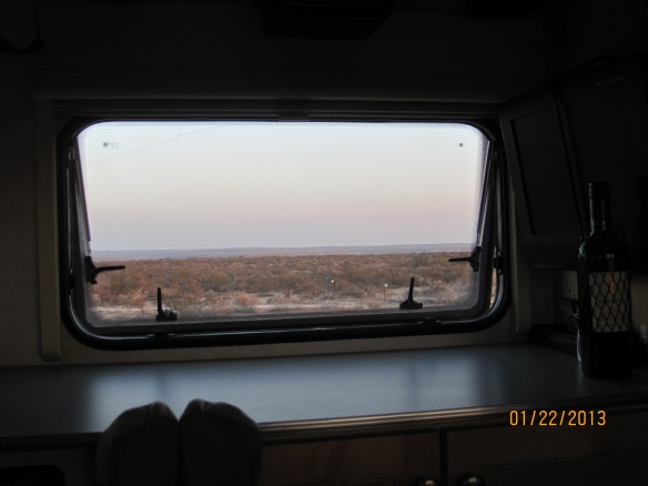 look past my feet to see the view from our camper window.