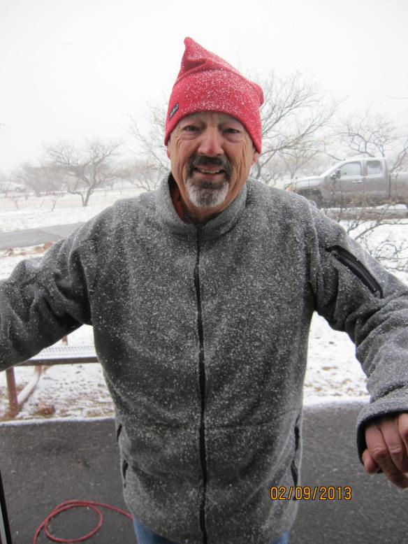 John covered in snow.  Surprise for our Saturday morning.