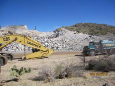 granite mining appears to be just busting boulders out of the hill.