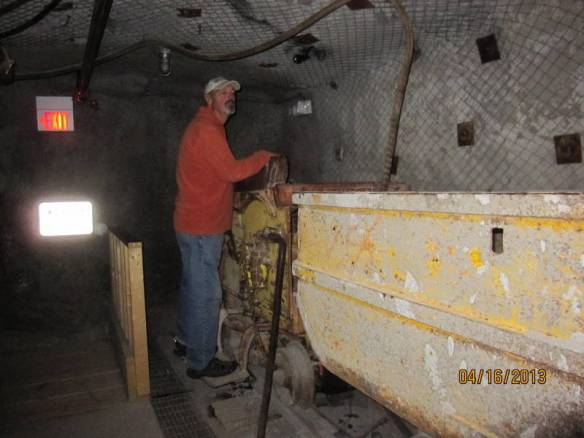 John checks out an ore bucket at the NM Museum of Mining in Grants