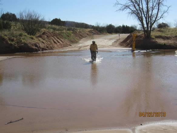 John navigates his way thru the flooded street