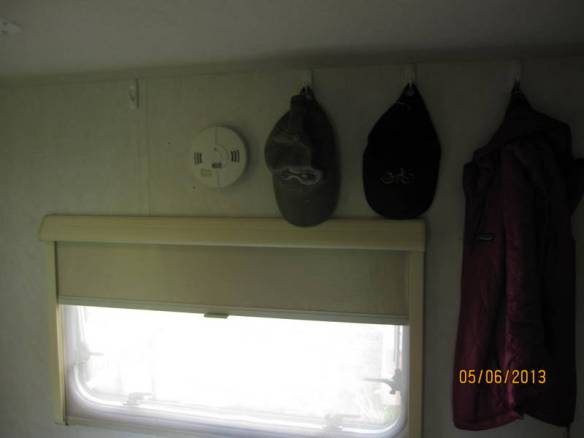 Unused space above the window is great for hats.  Bulky stuff hangs on sides.
