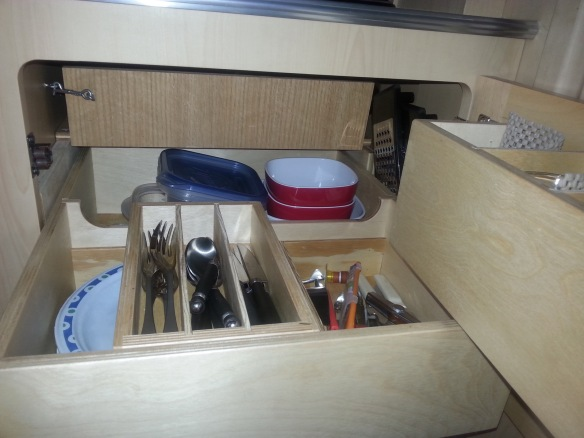 Sliding compartments keep help us make better use of some of the vertical space.