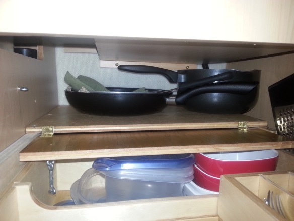 Pots and pans on the shelf.  We have another larger frying pan stowed here, which is not shown in photo.