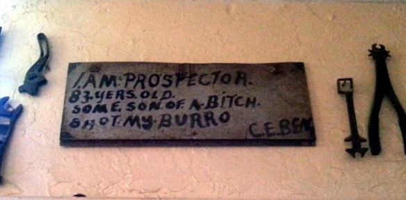 an old sign on the wall inside the bar